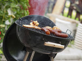Sausages on a grill — Stock fotografie