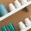 Stock Photo: Mugs and cups on the shelf