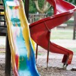 Playground slide and children's area — Stock Photo