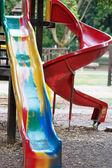Playground slide and children's area — 图库照片
