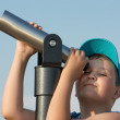 Stock Photo: Young boy and telescope