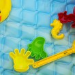 Baby toys at poolside — Stock Photo #30088885