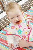 Little baby girl feeding with a spoon — Stock Photo
