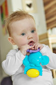 Cute baby girl with a toy — Stock Photo