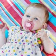 Caucasian little baby girl with multicolored frock — Stock Photo