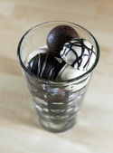 Chocolate bonbons in glass — Stock Photo