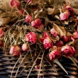 Dried roses in a wicker basket — Stock Photo