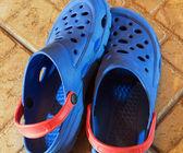 Blue plastic slippers — Stock Photo