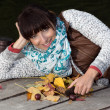 Stock Photo: Young woman with autumn decoration