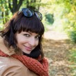 Beautiful woman posing in autumn park — Stock Photo
