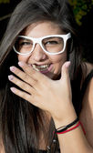 Young smiling girl with white sunglasses — Stock Photo