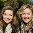 Portrait of two young smiling women in autumn outdoors — Foto de Stock   #34973135