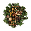 Christmas wicker basket with decorations and a branch of pine — Stock Photo