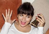 Young beautiful woman ringing christmas hand bell — Zdjęcie stockowe