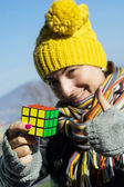 Woman enjoys for resolving of Rubik's cube — Stock Photo