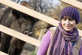 Portrait of a woman with the European bison (Bison bonasus) behi — Stock Photo