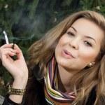 Young caucasian woman smokes a cigarette — Stock Photo #37032485