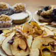 Dried sliced apples and tasty cookies — Stock Photo