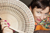 Joyful caucasian woman with a fan — Stock Photo