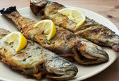 Three delicious grilled trouts — Stock Photo