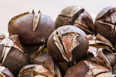 Pile of roasted chestnuts — Stock Photo