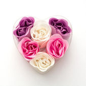 Little heart made of fabric flowers — Stock Photo