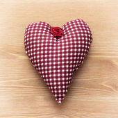 Red heart of fabric — Stock Photo