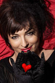 Beautiful caucasian woman with red heart in hands — Stock Photo