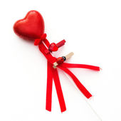 Red decorative valentine heart on a wand — Stock Photo