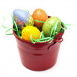 Stock Photo: Red bucket with colorful easter eggs