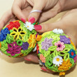 Woman holding in the hands two colorful easter eggs — Stock Photo #41014435