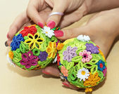 Woman holding in the hands two colorful easter eggs — Stock fotografie