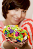 Young smiling woman holding in the hands two colorful easter egg — Stock Photo