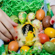 Stock Photo: Womholding basket with easter painted eggs in hands