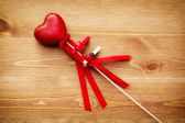 Beautiful red heart on a wand — Stock Photo