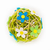 Beautiful sphere made of bound wicker with florets — Stock Photo