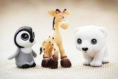Three plastic toy figurines — Foto Stock