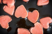 Chocolate pudding with little hearts of marzipan — Foto de Stock