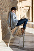 Beautiful caucasian woman posing on a bench — Stock Photo
