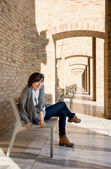 Pretty woman posing on a bench — Stock Photo