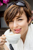 Beautiful young woman with coffee — Stock Photo