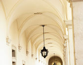 Vaulted ceiling with ornate iron lamp — Stock Photo