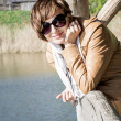Caucasian woman on a pier at the lake — Stock Photo #50448211