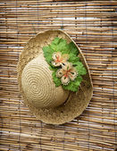 Lady straw hat with decorative flower ribbon — Stock Photo