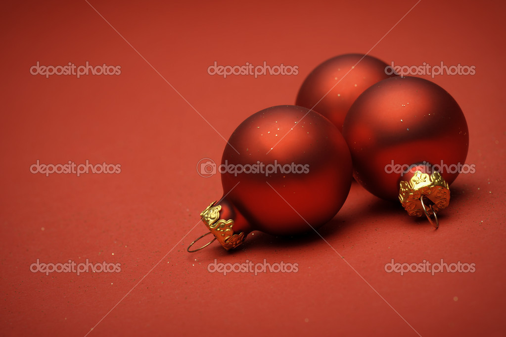 Red christmas balls on red background — Stock Photo #14900743