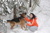 Teenager girl and German Shepherd dog — Stock Photo