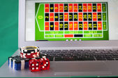 Laptop and Dice — Stock Photo