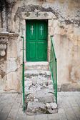 Green church door — Stock Photo