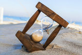 Hourglass on the Beach — Stock Photo