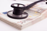 Euros with Black Stethoscope — Stock Photo